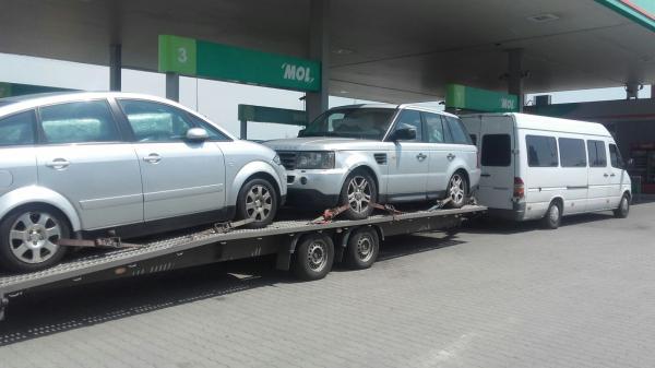 Tractare auto pe platforma Italia Romania range rover si audi a2