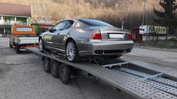Transport auto pe platforma Pitesti Romania Bologna Italia maserati