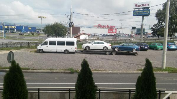 Transport auto pe platforma Romania Italia peugeot 508 si bmw 320i