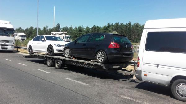 Transport autovehicule pe platforma Italia Romania vw golf 5 si bmw seria 3